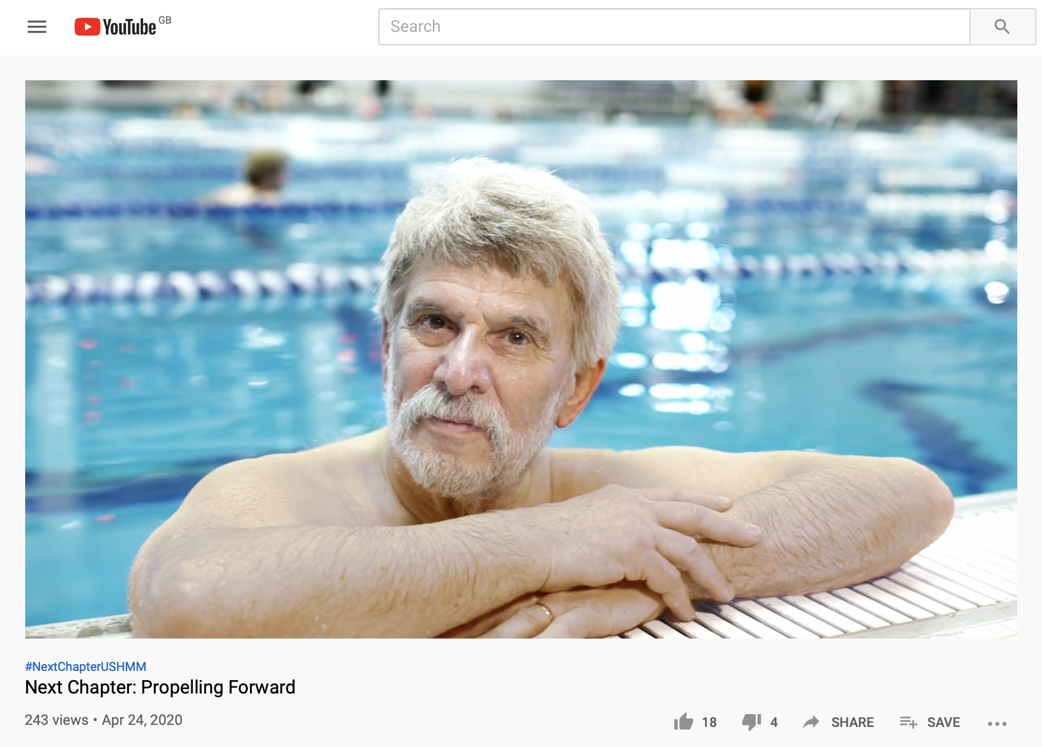 Peter Gorog leans poolside, looking directly into camera from the swimming pool
