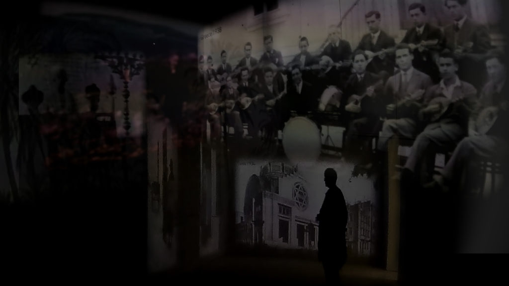 Images of pre-war Jewish life projected onto the inside walls of Block 27 at Auschwitz I. A digital collage by the author.