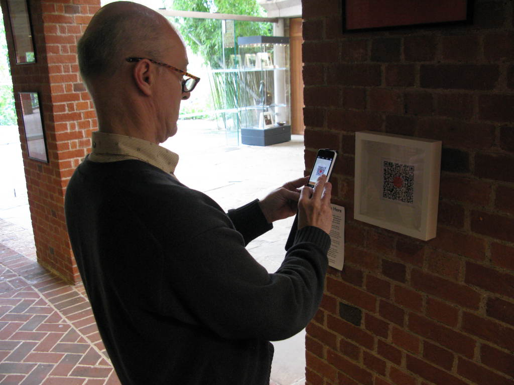 You Are Here: Nick Till, Professor of Opera & Music Theatre/Director of the University of Sussex Centre for Research in Opera and Music Theatre, accessing a QR code at Glyndebourne.