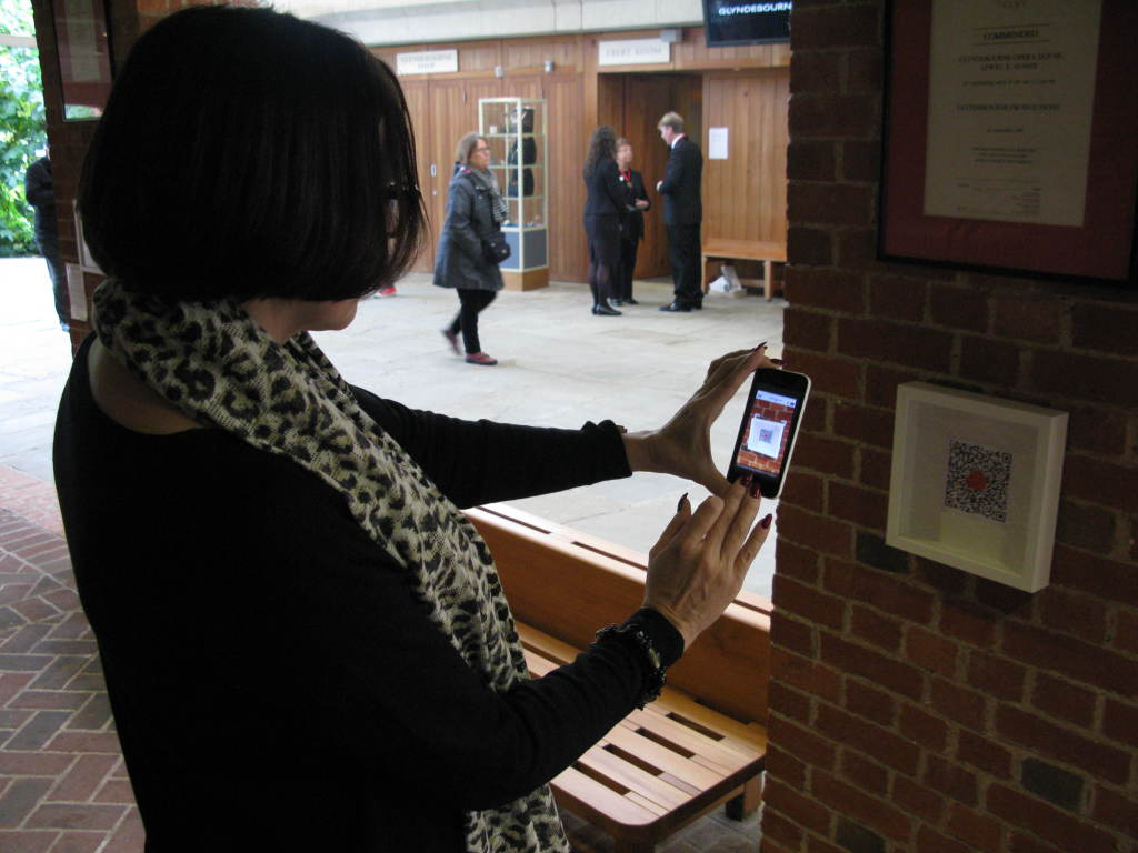 You Are Here: Liisamaija Hautsalo, musicologist and researcher from the Sibelius Academy, activating a QR code